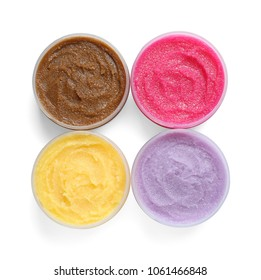 Containers with natural scrub on white background, top view