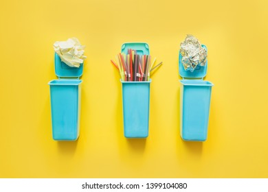 Containers for separate collection garbage with plastic straw, paper, metal foil. Top view. Concept save planet.