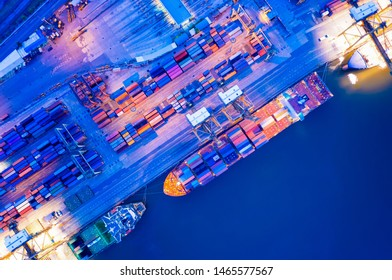 Containers yard in port congestion with ship vessels are loading and discharging operations of the transportation in international port.Shot from drone.