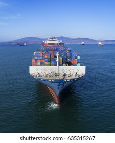 container-ship carrier is in the bay in anticipation of unloading