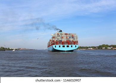 containership leaving the port of hamburg