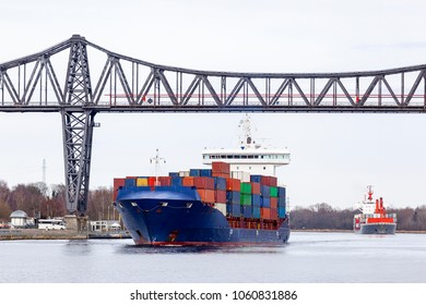 Containership on Kiel Canal near Rendsburg, Germany
