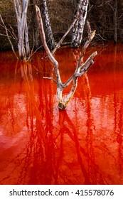 Contaminated red lake in Romania
