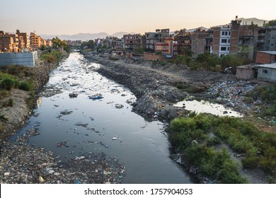 Contaminated river runs through city. waste is discarded river bank. lack of waste collection services. Kathmandu, Nepal, Asia