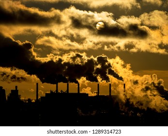 Contamination of environment by heavy smoke from industrial plant