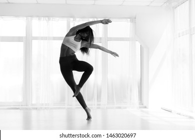 Contemp Girl Dancing In Modern Dance Class. Black And White, Free Space
