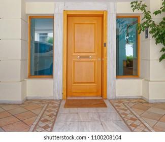 contemporary apartment building entrance wooden door, Athens Greece
