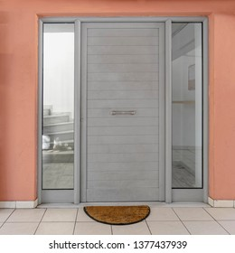 contemporary apartment entrance metallic grey door and pink wall, Athens Greece