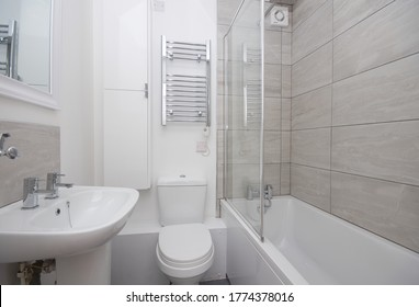 Contemporary Apartment Fully Tiled Modern Bathroom Design with Chrome Fittings London UK 2020