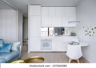 Contemporary apartment interior with small modern and white kitchenette