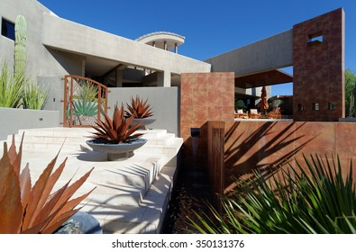 Contemporary architectural style luxury home exterior, eye-level view