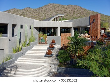 Contemporary architectural style luxury home exterior, front stairs view