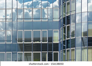 Contemporary Architecture with Sky and Cloud Reflection