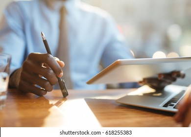 Contemporary author with pen and touchpad