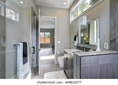 Contemporary bathroom features a dark vanity cabinet and walk-in shower. Northwest, USA