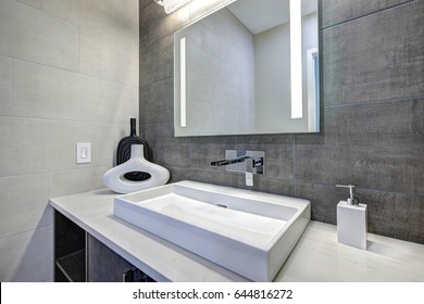 Contemporary bathroom interior with tile wall surround in grey tones. Northwest, USA