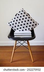 Contemporary black dining chair with modern cross pattern cushion