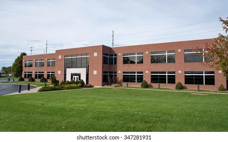 Contemporary Brick Business Building with Lawn