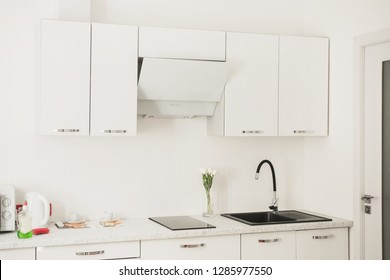 Contemporary ceramic sink with tap in the luxury kitchen. New black faucet. Modern apartment. Tap with in the kitchen. Steel chrome faucet. Sink from black stone. Luxury home