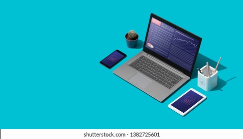 Contemporary corporate business desktop with laptop and isometric objects, finance and trade concept
