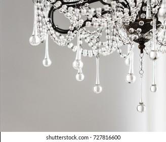Contemporary crystal chandelier in room interior. Close up