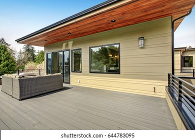 Contemporary deck features a modern wicker sectional. Northwest, USA