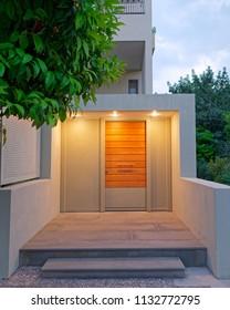 contemporary design apartment building entrance door, illuminated