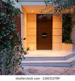 contemporary design house entrance dark brown metallic door, illuminated