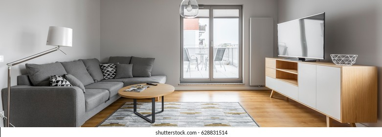 Contemporary designed living room with window door to the terrace, panorama