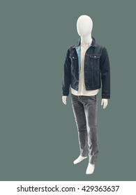 Contemporary elegant fashion apparel on male mannequin, isolated. No brand names or copyright objects.