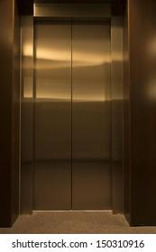 contemporary elevator interior with metal doors