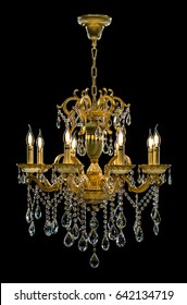 Contemporary gold chandelier isolated on black background. Crystal chandelier
