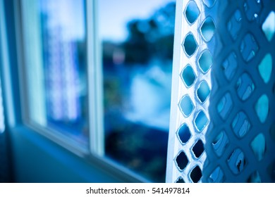 Contemporary home with blue and white with diamond shapes curtain and window