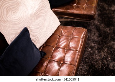 Contemporary home with brown leather sofa with white and blue pillows