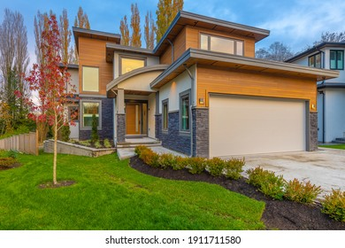 Contemporary home exterior with vibrant fall colors and blue sky