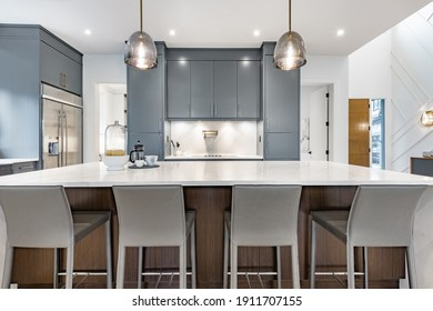 Contemporary home with open concept living and bright white decor - Shutterstock ID 1911707155