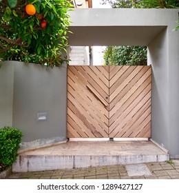 contemporary house cozy entrance wooden door, and orange tree