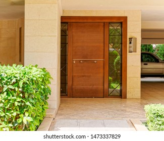 contemporary house entrance with natural wood door, Athens Greece