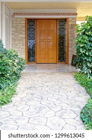Contemporary house entrance stone path to the wood and glass door, Athens Greece