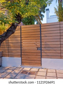 contemporary house modern wooden fence and door, late in the  evening