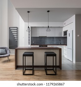 Contemporary interior with kitchen island and bar stools
