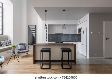 Contemporary interior with kitchen island, bar stools and cozy window seat