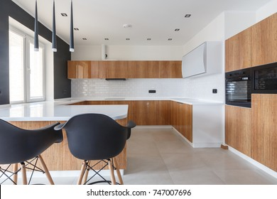 Contemporary kitchen in classical style with loft details. Luxury apartment downtown. Breakfast zone in comfortable brand new apartment.