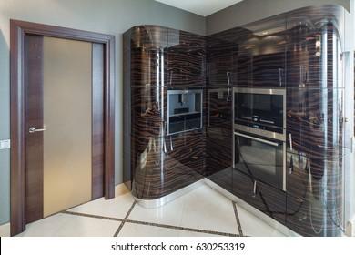 Contemporary kitchen interior. Wooden furniture. Luxury style.