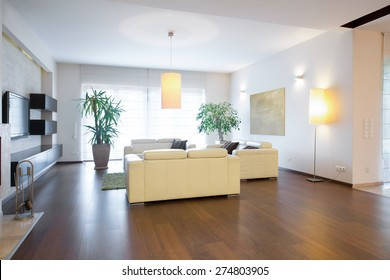 Contemporary living room with oak floor