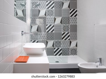 Contemporary loft bathroom with walk in shower unit and black and white monochrome porcelain wall tiles.