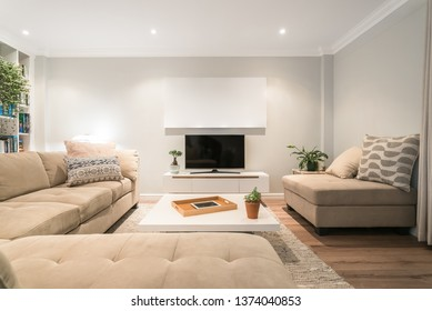 Contemporary lounge with modern decoration, coffee table, tv stand, bookshelf and indoor plants