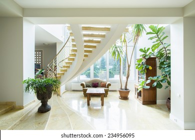 Contemporary luxury mansion interior with spiral stairs