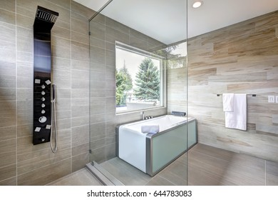 Contemporary master bathroom features modern tub and glass walk-in shower in a new home. Northwest, USA