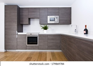 Contemporary modern fully fitted kitchen in brown with top spec appliances and granite worktops
